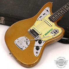 1965 Fender Jaguar Firemist Gold   Rock N Roll Vintage   Reverb #vintagefenderguitar Carl Wilson, Fender Jaguar, Johnny Marr, Guitar Collection, Fender Guitars, Rock N Roll, Acoustic, Gold, Bass