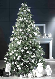 Loving the WHITE & Silver tree decor and Polar Bears and a Penguin <3