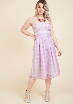 <p>There's something so delightful about dressing up in this light purple dress before the weekend ends! Sweetening up your look with delicate straps, a sheer, gingham overlay topping elegant ivory lining, and waistline pleats, this lovely ModCloth-exclusive midi kindles an irreplaceably stylish excitement that'll set an inspiring tone for your week.</p>