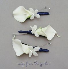 corsages. coral ribbon and smaller flower should be a rose of different color