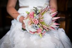 Pink King protea with pink roses, white and pik lisianthus and brunia (flowering December RSA) King Protea, Girls Dresses, Flower Girl Dresses, Pink Roses, Wedding Dresses, Bouquets, Flowers, December, Vintage