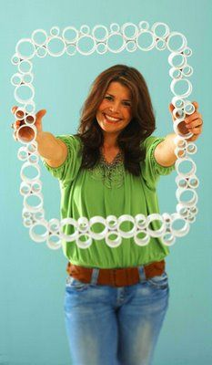 PVC Pipe Frame. I LOVE this! And how easy to just paint all the circles different colors before you attach them. :)