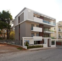 Google Image Result for http://www.architravel.com/files/buldingsImages/bulding1953/Apartment_Building_in_Melissia_Office_25_Architects_2.jpg