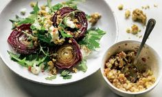 Yotam Ottolenghi's baked red onions with walnut salsa Photograph: Colin Campbell for the Guardian