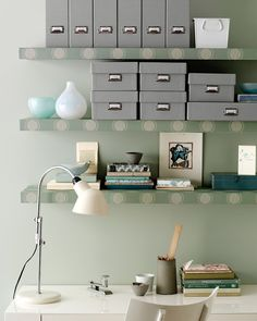 Add a splash of personality to a lackluster workspace by covering plain floating bookshelves with wallpaper.