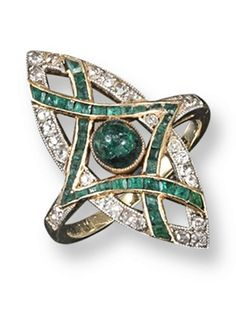 A Russian Art Nouveau emerald and diamond set navette shaped ring, centred with…