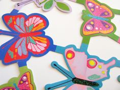 Adorable die-cut images of butterflies, with glitter