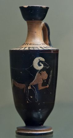 "Odysseus is tied under the belly of the ram to right, looking up; he is beardless, with short chiton and sword held up in left hand. He is painted red throughout, the ram's horns and breast white. In the field, imitation inscriptions.  Pottery lekythos decorated in the ""six technique"" style. Design black, indicated by incised lines, on a black ground, with red and white accessories; neck and shoulder red with black and white rays. (source British Museum WEB Site)  Made in Attica, Athens…"