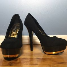 """Michael Antonio Black and Gold Pump Black and gold patent wrap for heel and platform. Synthetic. Faux Suede. Heel measures 5.25"""". Platform measures 1.75"""". Very gently worn. Without box. Michael Antonio Shoes Heels"""