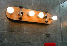 "Skateboard upcycled into Bathroom Vanity Lighting Fixture. Wall lamp. 31"". $245.00, via Etsy."
