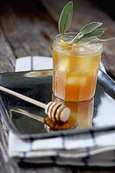 Bourbon with Sage Honey Simple Syrup 2 oz. kentucky bourbon, honey & sage simple syrup, 1 orange peel, 1 sprig of sage.