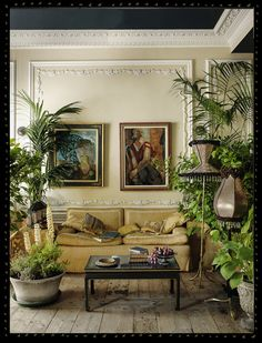 This high ceilinged, heavily corniced living room woth its sumptuous sofa is perfectly framed by greenery. Created by Sera of London. Photo by Michael Paul