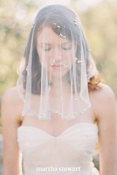 Veils come in all shapes and sizes and often the go-to for most brides, shorter, daintier accessories, like this one by SIBO Designs, have an impact, too. Crystals lined the edge of the chin-length headpiece; sparkly clusters were also placed throughout the fabric for an extra dose of shine. #weddingideas #wedding #marthstewartwedding #weddingplanning #weddingchecklist Short Bridal Hair, Chapel Length Veil, Short Veil, Blue Wedding Dresses, Dress Wedding, Wedding Blog, Nontraditional Wedding, Bohemian Bride, Wedding Veils