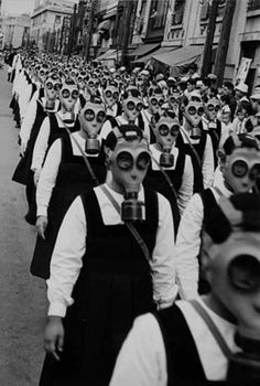 """This is one of the most haunting pictures I have ever seen. Schoolgirls in gas masks, WWII. And all I can think of is """"are you my mummy? Old Photos, Vintage Photos, John Thomas, Arte Obscura, Interesting History, Vintage Photography, People Photography, Photography Courses, Macabre"""