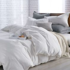 All the best bedding deals from Nordstrom's Anniversary Sale. White Comforter Bedroom, Grey And White Bedding, Comfy Bedroom, White Bedroom, Comforter Sets, White Bed Comforters, King Comforter, Fluffy White Bedding, White Bedding Decor