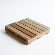 Set of 4 These mini shipping pallet coasters are made from actual shipping pallets. Each set contains four coasters ready and willing to satisfy all your drink setting needs. Dimensions: 4 x 4 x 3/4 i