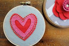Embroidery Hoop Art. Layered and Stitched Heart. Pink and Red on Grey