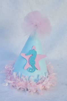Mermaid Princess Birthday Party Hat in Pale Pink and Seafoam with starfish and seahorse. $11.50, via Etsy.