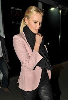 Charlize Theron Rocks Leather Pants and pink blazer in Paris