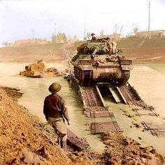 An Achilles 17pdr tank destroyer of the 93rd Anti-Tank Regiment crossing the River Savio in Cesena, Italy on a Churchill ARK bridge which was driven into the river by the 7th Field Company RE. 24 October 1944.