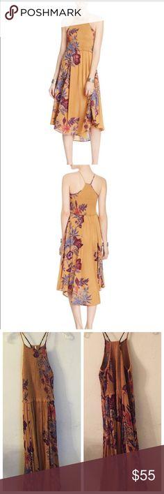 """Cyber mon! free people xs seasons in the sun dress Worn only once! No defects- Free People's summer-ready sundress offers a more conservative way to indulge your inner boho babe. smocked, fitted bodice with a fluid, floral-printed skirt. Rayon. Hand wash or dry clean Made in India Round neck, sleeveless, smocked bodice Gathered skirt, asymmetric hem, racerback Allover floral print, pullover style Approx. 47"""" from back of neck to hem, based on a size xs Model measurements: 5'10"""" height, 33.5""""…"""