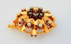 Antique Gold Art Deco Brooch with 8 diamonds and 11 pearls.