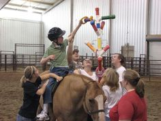 Playing games in hippotherapy -- helping the children perform stretches without realizing it!