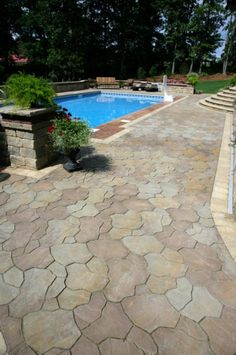 Trevia paver pool deck with estate wall pillar - all by Unilock