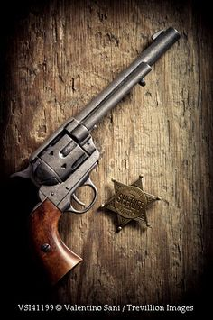 Trevillion Images http://www.trevillion.com/search/preview/old-gun-with-sheriff-badge/0_00072136.html