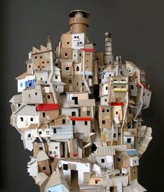 Cardboard sculpture inspired by the favelas (shanty towns) of Brazil. Cardboard City, Cardboard Sculpture, Cardboard Paper, Cardboard Crafts, Cardboard Model, Paper Clay, Cardboard Houses, Favelas Brazil, Paper Houses