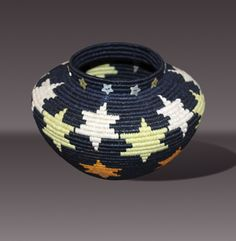 "Carol Emarthle-Douglas | ""Lightening my Path"". Northern Arapaho-Seminol.  Coiled waxed linen thread, hemp core, embellished with  ""star""shaped shell button beads"
