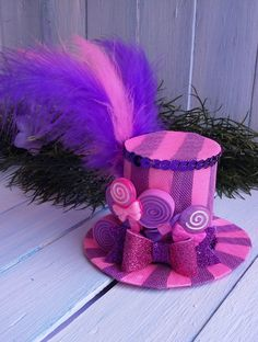 Mini Top Hat Lollipop Mini Top Hat Headband Mad Hatter Hat Alice in Wonderland Pink Candy Top Hat Fascinator Tea Party Hat Purple Mini Hat by beautiheadband on Etsy https://www.etsy.com/ca/listing/523568142/mini-top-hat-lollipop-mini-top-hat