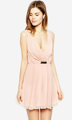 Made from a breathable woven fabric. V-neckline. Wrap front with bar detail. Sheer straps and back d...