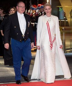 H.S.H. Princess Charlene of Monaco in Akris at the Gala celebrating Monaco National Day, wearing a white sleeveless A-line silk gown with hand stitched leather dots and a cashmere double-face coat. #akris #princesscharlene #monaco