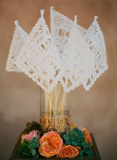 Spanish style: papel picado flags, meant to be waved as the bride and groom pass by...