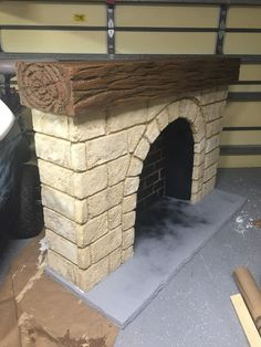 """Stone Fireplace for Theatre Prop Stone Fireplace for Theatre Prop: I'm working on the set for \""""Into the Woods\"""" and started with Cinderella's fireplace. Cardboard Fireplace, Fireplace Logs, Christmas Fireplace, Diy Christmas, Christmas Decorations, Fireplace Decorations, Shiplap Fireplace, Stone Fireplaces, Fireplace Ideas"""