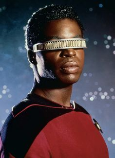 Lieutenant Geordi La Forge played by LeVar Burton who appeared in all seven seasons of the American science fiction television series Star Trek: The Next Generation and its four feature films. - wearing his trademark VISOR. Star Trek Enterprise Ship, Star Trek Starships, Star Trek Voyager, Uss Enterprise, Star Trek 2009, Star Trek Series, Wallpaper Star Trek, Star Trek Characters, Movie Characters