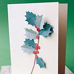 A sprig of holly springs to life from atop a store-bought plain note card. This project wouldn't fare well in the mail, so save it for greetings you're planning to deliver by hand.