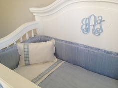 Great personal touch in the nursery - monogram on the crib!