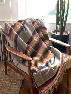 Vintage serape x base is an earthy sand color. feels like a wool cotton blend. In decent condition a few small holes and spots (as seen in photos). It was acquired in vintage condition and I haven't attempted to clean it. Serape Fabric, Earthy, Buy And Sell, Throw Pillows, Blanket, Cotton, Handmade, Stuff To Buy, Vintage