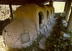 This unusual ceramic kiln is a noborigama type (登り窯), and is located in Gallifa, Catalonia. So, what does a classic japanese style kiln in a tiny catalan village?    Well, it's located just behind the house and workshop of J. Llorens Artigas, a ceramist that worked with Picasso and Miro