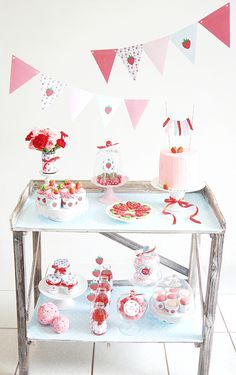 Strawberry themed birthday party with lots fo DIY decorations, printables, food and favors!