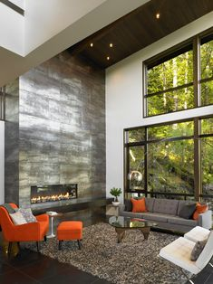 2-Story Metallic Fireplace in Contemporary Waterfront Hideaway - Gambier Island BC Canada [742  990]