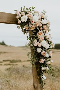 The Love in This Cuffey's Cove Ranch Wedding on the Mendocino Coast will Take Your Breath Away Rustic ceremony backdrop adorned with romantic pink and white roses Rustic Wedding Flowers, Floral Wedding, Fall Wedding, Church Wedding, Wedding Night, Boho Wedding, Wedding Reception, White Roses Wedding, Wedding Flower Guide