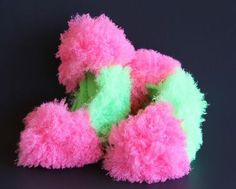 Hot Pink & Green Poodle Curl Fuzzy Soakers.  A super cute way to store your figure skates in style!  Get them at Kinzie's Closet!