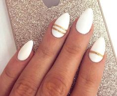 Almond-shaped acrylic nails with gold striped accents