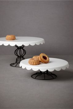 inspiration idea for thrift-score wrought iron candle sticks and high-gloss white painted chargers or porcelain platters