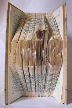 handgefaltetes Buch Schriftzug smile