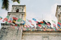 Church and Colorful Flags in Playa del Carmen Mexico   photography by http://www.laurelynsavannahphotography.com