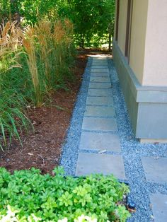 Great way to have a  clean, neat pathway around the house - allows moisture to drain away from the house and provides easy access to the beds nearby